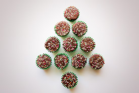 Cupcakes with sprinkles in the shape of a Christmas tree